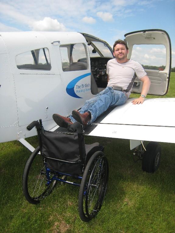 Pilot sitting on wing of BDFA PA28